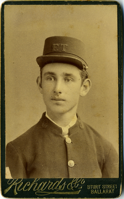 Carte de visite of young Australian man in uniform, with initials E. T. on his cap, possibly Electric Tramway.