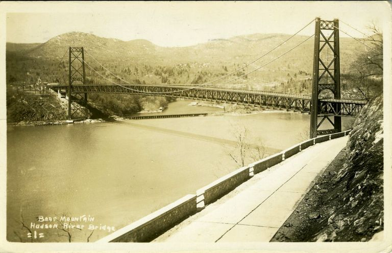 Advertising real photo postcard, the construction of the Bear Mountain Bridge. John Roebling, Haines Motor Service.