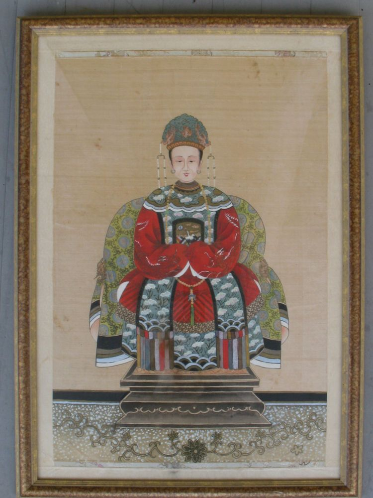 A Pair of Qing Dynasty Ancestor Portraits, the Court Official in deep blue robes, his wife in red.