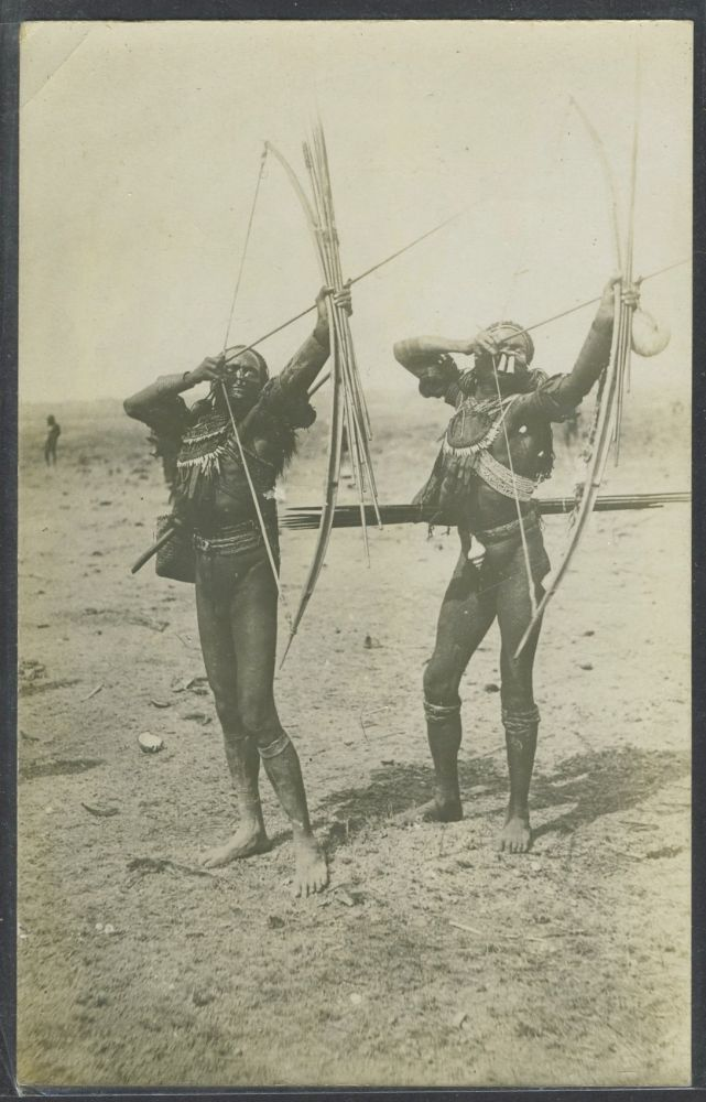 Real photo postcard of two Papua New Guinea tribesmen. New Guinea.