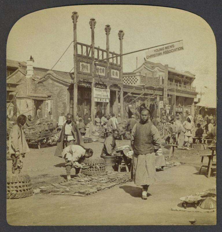 Chinese street scene with YMCA Reading room in background, photograph.