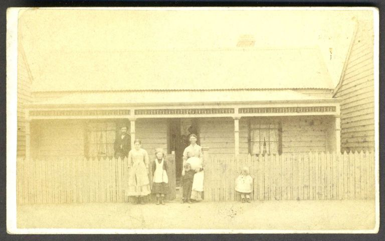 Carte-de-visite of Australian family in front of their home in Victoria. Wall Australian Photo. Co., Proprietors Co.