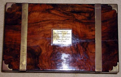 Walnut writing box presented to Rev. Thomas Ellis Jones by the Beryl St. Baptist Church, Broken Hill, NSW, December 1st 1896. Broken Hill.
