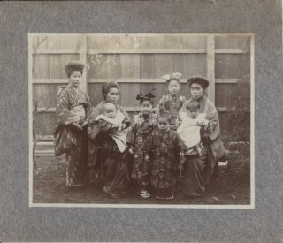 Photograph of Two Japanese Women with a Teenager and Five Children.