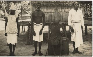 Photograph of Three Men and a Woman in Rabaul, Papua New Guinea.