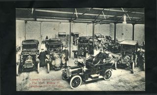 Real Photo Postcard of Lovett's Motor Garage in Ealing, London.