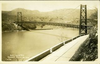 Advertising real photo postcard, the construction of the Bear Mountain Bridge. John Roebling,...