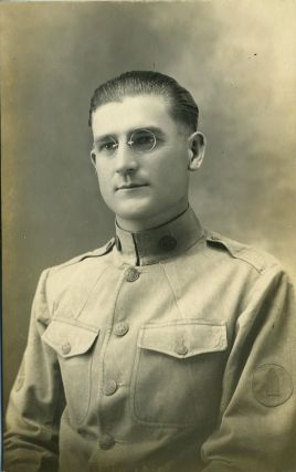 Studio portrait of a World War I soldier. Real photo postcard