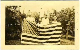 Family Holding Flag. Photograph