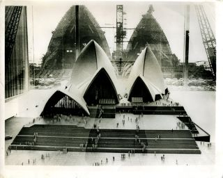 Sydney Opera House under construction: photograph of the architectural model juxtaposed in front of the Opera House under construction. Joern Architecture; Utzon.