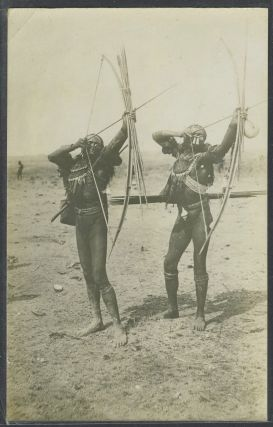 Real photo postcard of two Papua New Guinea tribesmen. New Guinea