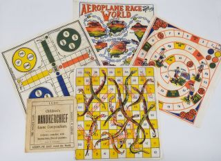 """Children's Handkerchief Game Compendium"". Four textile game boards and instruction booklet...."