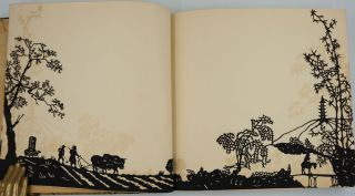 """""""Our Guests"""", a guest book with silhouette images."""