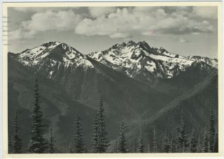 The Portfolios of Ansel Adams [with] signed and franked Ansel Adams photo postcard.